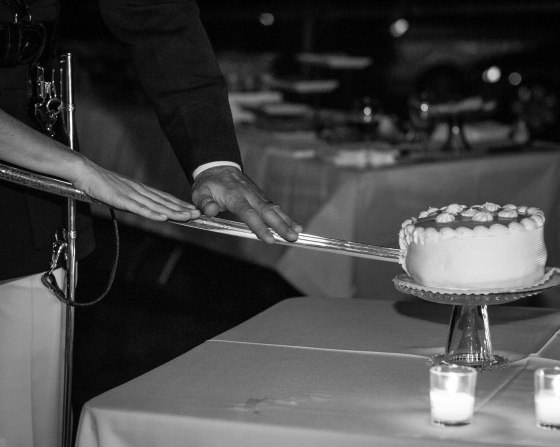 Cutting the cake with Michael's sword.  How sad is that cake?! Oh well...